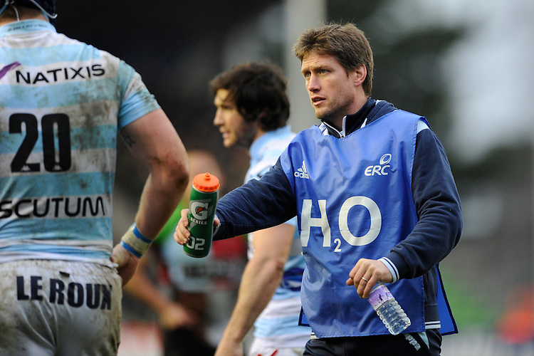 Ronan O'Gara, Consultant Racing Metro 92, brings the water on during the Heineken Cup match between Harlequins and Racing Metro 92 at the Twickenham Stoop on Sunday 15th December 2013 (Photo by Rob Munro)