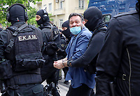 Pictured: Ioannis Lagos, former member of far-right Golden Dawn party arrives at the prosecutor's office under heavy police presence in Athens, Greece. Saturday 15 May 2021<br /> Re: Giannis Lagos, a Greek member of the European Parliament and convicted neo-Nazi arrested in Belgium and extradited on a European warrant, has appeared before a prosecutor in Athens, Greece.<br /> Ioannis (Giannis) Lagos, a 48-year-old former nightclub bouncer and former member of the banned Golden Dawn party had been arrested in Brussels and is due to serve a 13-year jail term in Greece.<br /> The prosecutor decided that Lagos should be sent directly to Domokos prison in central Greece.