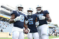 CHAPEL HILL, NC - OCTOBER 10: Michael Carter #8 of North Carolina celebrates with teammates Dazz Newsome #5 and Joshua Ezeudu #75 after a 62-yard touchdown run during a game between Virginia Tech and North Carolina at Kenan Memorial Stadium on October 10, 2020 in Chapel Hill, North Carolina.