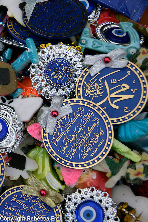 Amulets for sale with arabic script from the koran for hanging in homes, Istanbul, Turkey. Amulets against the evil eye can also be seen.