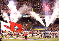 Arkansas football players and cheerleaders run on the field before the game during 77th Annual Allstate Sugar Bowl Classic at Louisiana Superdome in New Orleans, Louisiana on January 4th, 2011.  Ohio State defeated Arkansas, 31-26.