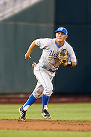 UCLA shortstop Pat Valaika (10) on defense against the North Carolina State Wolfpack during Game 8 of the 2013 Men's College World Series on June 18, 2013 at TD Ameritrade Park in Omaha, Nebraska. The Bruins defeated the Wolfpack 2-1, eliminating North Carolina State from the tournament. (Andrew Woolley/Four Seam Images)