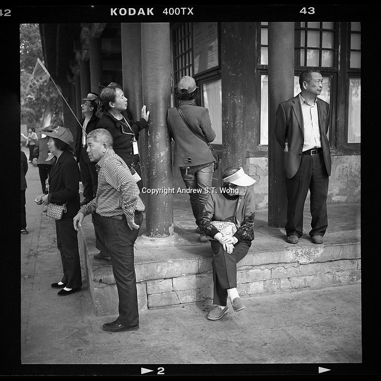 Chinese tourists visit the Summer Palace in Beijing, China, April 2014.