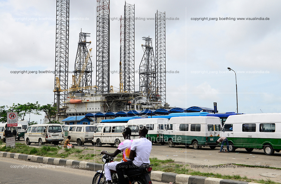 NIGERIA, City Lagos, two oil platform laying in Lagos port, Oritsetimeyin and Onome, traffic and VW Minibus