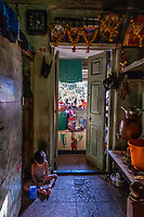 India, Maharashtra, Mumbai, Bombay, red light district. Child waiting in the brothel while his mother, a sex-worker, is servcing a client.