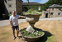 """19/06/18<br /> <br /> ***With video  https://www.youtube.com/watch?v=dRLkN49V02k  ***<br /> <br /> Spencer Tallis with pot from Pompeii.<br /> <br /> It's not just a 'good year for the roses', it might be the best ever year for the roses.<br /> <br /> The colours from a rose garden in the Derbyshire Dales stand out like an oasis surrounded by parched fields because, unbelievably, the roses need NO water to bloom.<br /> <br /> Julie Thomas (59) who owns Hopton Hall near Ashbourne said: """"The roses are the best they've ever been, they love the dry hot and sunny conditions - we don't even need to water them. <br /> <br /> """"Usually the rain would knock the petals off and we be busy dead-heading at this time of year but there's hardly anything to do at the moment. The blooms are in a kind of drought state - the flowers are staying for much longer than usual. And there are lots more flowers coming too.<br /> <br /> The classic walled english rose garden was planted with 2000 roses 12 years ago by estate manager, Spencer Tallis (51). He planted all the roses and plants in the garden in 2004 and has since made it his life's work tending them.<br /> <br /> """"I do have to water the box hedges a little but the roses are looking after themselves. Normally at this time of year we'd all be busy dead-heading but there's hardly anything to do at the moment""""<br /> <br /> Julie and her family bought the property eight years ago and have continued to plant and care for the rose garden and now open the garden for visitors.<br /> <br /> All Rights Reserved: F Stop Press Ltd. +44(0)1335 344240  www.fstoppress.com www.rkpphotography.co.uk"""