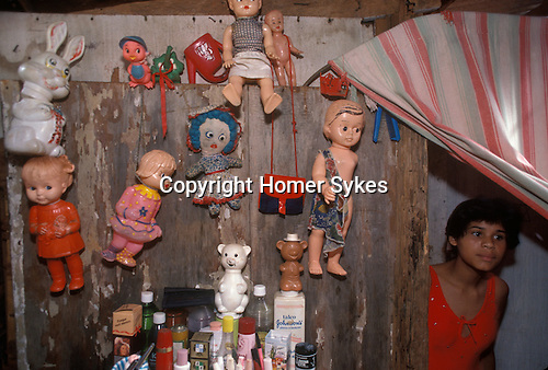 Favela Brazil inside slum house childrens dolls pinned to the wooden wall for decoration a bedroom Brasilia South America  1985 1980s