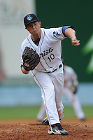 Asheville Tourists pitcher Josh Hungerman #10 delivers a pitch during a game against the Augusta Green Jackets at McCormick Field on July 10, 2011 in Asheville, North Carolina.  Augusta won the game 10-2.   (Tony Farlow/Four Seam Images)