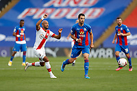 12th September 2020; Selhurst Park, London, England; English Premier League Football, Crystal Palace versus Southampton; Luka Milivojevic of Crystal Palace and Nathan Redmond of Southampton look on