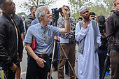 Heckler, Speakers' Corner, Hyde Park, London, where the use of video cameras and smartphones to record speakers, preachers, sermons and arguments, for broadcast via social media, has become widespread in recent months.