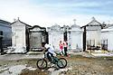 Boy rides bike in St. Joseph Cemetery No. 1, 2014