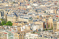 Birds eye view of adjacent buildings and roof tops on the North side of the Seine river from the observation deck of the Eiffel Tower, Paris, France