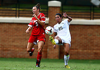 WINSTON-SALEM, NORTH CAROLINA - September 01, 2013:<br /> Kari Weinland  (7) of Louisville University gets the ball booted into her by Annick McBryar (25) of Wake Forest University during a match at the Wake Forest Invitational tournament at Wake Forest University on September 01. The match was abandoned early in the second half due to severe weather with Wake leading 1-0.