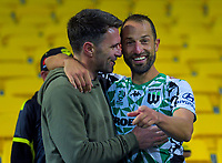 United's Andrew Durante catches up with former Phoenix teammate Tim Brown (left) after the A-League football match between Wellington Phoenix and Western United FC at Sky Stadium in Wellington, New Zealand on Friday, 21 February 2020. Photo: Dave Lintott / lintottphoto.co.nz