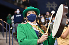 October 9, 2021; Leprechaun Sophie Bouldoukian leads cheering at a hockey game. (photo by Matt Cashore/University of Notre Dame)