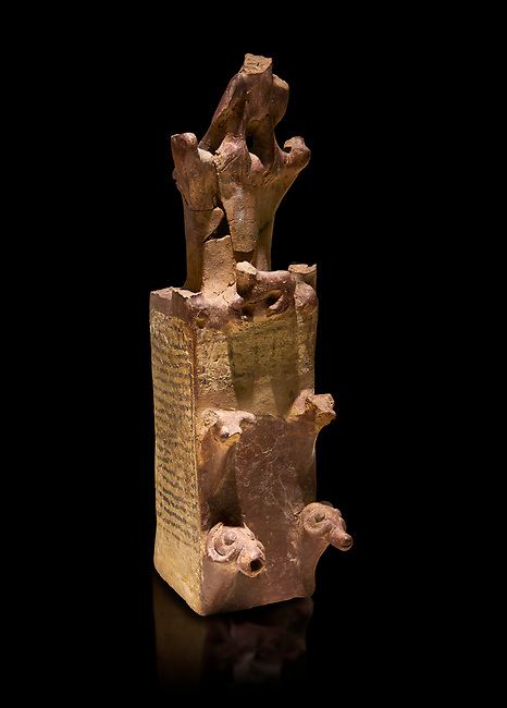 Hittite terra cotta tower shaped vessel representing a two storey tower of the city walls complete with merlons - 14th century BC - Hattusa ( Bogazkoy ) - Museum of Anatolian Civilisations, Ankara, Turkey . Against black background