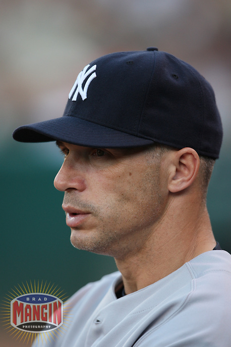 OAKLAND, CA - JUNE 11:  Manager Joe Girardi of the New York Yankees stands in the dugout and watches the game during the game against the Oakland Athletics at the McAfee Coliseum in Oakland, California on June 11, 2008.  The Athletics defeated the Yankees 8-4.  Photo by Brad Mangin