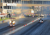 Jul, 22, 2011; Morrison, CO, USA: NHRA top fuel dragster driver Terry McMillen (left) has a small fire during qualifying for the Mile High Nationals at Bandimere Speedway. Mandatory Credit: Mark J. Rebilas-