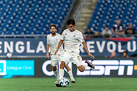 FOXBOROUGH, MA - AUGUST 5: Luis Arriaga #8 of North Carolina FC passes the ball during a game between North Carolina FC and New England Revolution II at Gillette Stadium on August 5, 2021 in Foxborough, Massachusetts.