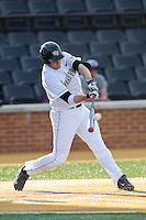 Will Craig (22) of the Wake Forest Demon Deacons connects for a three-run home run in the bottom of the first inning against the High Point Panthers at Wake Forest Baseball Park on April 2, 2014 in Winston-Salem, North Carolina.  The Demon Deacons defeated the Panthers 10-6.  (Brian Westerholt/Four Seam Images)