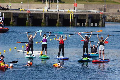 Paddle board safety volunteers at the Pickie to Pier swim