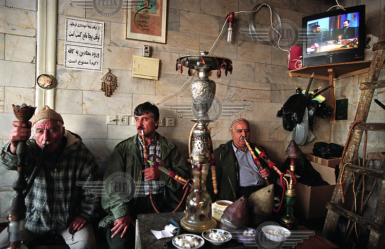 Kurdish men smoking the shisha (waterpipe) in a cafe.