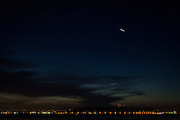 In the two and a half seconds captured in this exposure, the International Space Station drew a bright while line over San Francisco Bay at twilight.