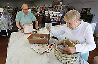 Doris Jennes (right), a volunteer, and her husband Karl, store manager, review recently donated items Friday, July 30, 2021, that included new small appliances and costume jewelry at the Northwest Medical Center Auxiliary Thrift Shop in Springdale. The store, located at 802 Quandt Avenue, is have a $1 sale on summer seasonal clothing items to make room for fall and winter merchandise. Check out nwaonline.com/210731Daily/ and nwadg.com/photos for a photo gallery.(NWA Democrat-Gazette/David Gottschalk)