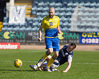 3rd April 2021; Dens Park, Dundee, Scotland; Scottish FA Cup Football, Dundee FC versus St Johnstone; Shaun Rooney of St Johnstone is slide tackled by Jordan Marshall of Dundee