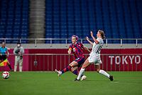 SAITAMA, JAPAN - JULY 24: Megan Rapinoe #15 of the United States shoots towards goal during a game between New Zealand and USWNT at Saitama Stadium on July 24, 2021 in Saitama, Japan.