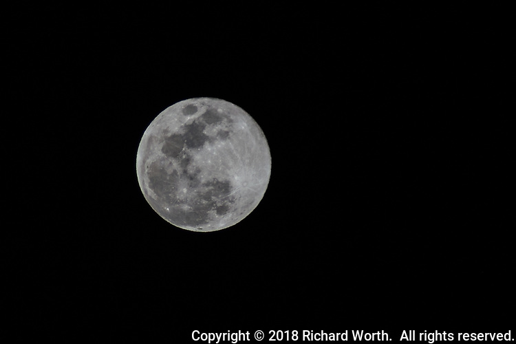 A break in the clouds allowed this capture of the Full Worm Moon shortly after rising over the San Francisco Bay area.  10 minutes later it was raining.