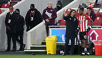 Brentford Manager, Thomas Frank gives some instructions to Ivan Toney ahead of the striker's return from injury as a second half substitute during Brentford vs Sheffield Wednesday, Sky Bet EFL Championship Football at the Brentford Community Stadium on 24th February 2021