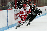 BOSTON, MA - JANUARY 11: Abbey Stanley #21 of Boston University crosses blue line as Isabelle Hardy #21 of Providence College defends during a game between Providence College and Boston University at Walter Brown Arena on January 11, 2020 in Boston, Massachusetts.