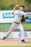 Relief pitcher Murilo Gouvea #34 of the Lexington Legends in action against the Kannapolis Intimidators at Fieldcrest Cannon Stadium on May 11, 2011 in Kannapolis, North Carolina.   Photo by Brian Westerholt / Four Seam Images