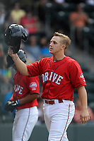 Catcher Jake Romanski (12) of the Greenville Drive is congratulated after scoring a run in a game against the Lexington Legends on Sunday, April 27, 2014, at Fluor Field at the West End in Greenville, South Carolina. Greenville won, 21-6. (Tom Priddy/Four Seam Images)