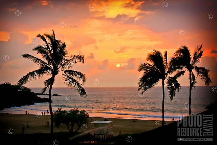 Surfers and other beachgoers enjoy sunset at Hapuna Beach State Park, Kohala Coast, Big Island.