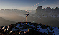 Christ on the Cross adorns a tall, rugged mountain in the Alps just outside Ortisei, Italy.  <br /> <br /> Aerials of the Alps just outside Ortisei, Italy.  This town is about 40 minutes from Bolzano and in the Val Gardena area of the Dolomites.