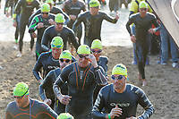 Pictured: Gareth Thomas (C) halfway through his swim race at the North Beach in Tenby. Sunday 15 September 2019<br /> Re: Ironman triathlon event in Tenby, Wales, UK.