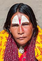 Nepal, Pashupatinath.  Female Hindu Sadhu (Ascetic).  She wears a nose pin in her nostril.