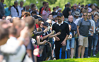 Pep Guardiola (Manchester City Manager) works his way through spectators during the BMW PGA PRO-AM GOLF at Wentworth Drive, Virginia Water, England on 23 May 2018. Photo by Andy Rowland.