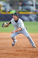 Coastal Carolina Chanticleers first baseman Richard Carter (10) charges towards home plate against the High Point Panthers at Willard Stadium on March 14, 2014 in High Point, North Carolina.  The Panthers defeated the Chanticleers 3-0.  (Brian Westerholt/Four Seam Images)