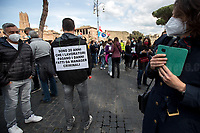 Rome, Italy. 16th Apr, 2021. Today, Alitalia, air transport, Airports, logistic, and related workers, led by CGIL, CISL, UIL, USB, CUB Trasporti Trade Unions, held a protest which started in Via dei Fori Imperiali against the plan under discussion between Mario Draghi's Italian Government and the European Union (EU - UE) to dismantle the flag carrier of Italy, make it a small and regional airline with a different name - while it is still one of the biggest airport slots owner in the world -, and to lay-off the majority of the workers of the Italian historical air company. During the demo, a group of protesters, patrolled by a conspicuous number of police officers, were allowed to demonstrate outside Campidoglio, the Rome's City Hall.   <br />
