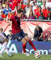 USA midfielder Sacha Kljestan (16) on the attack. In a friendly match, Spain defeated USA, 4-0, at Gillette Stadium on June 4, 2011.