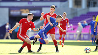 Orlando, Florida - Monday January 15, 2018: Chris Mueller is tripped by Cory Brown. Match Day 2 of the 2018 adidas MLS Player Combine was held Orlando City Stadium.