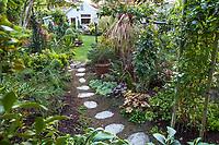 Stepping stone path into secret garden in California plant collector garden - Carol Brant