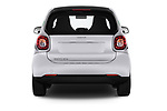 Straight rear view of a 2018 Smart fortwo prime coupe 3 Door micro car stock images