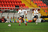 Carli Lloyd pushes the pace. The USA defeated Norway 2-1 at Olhao Stadium on February 26, 2010 at the Algarve Cup.