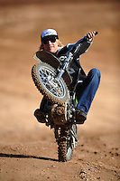 Dec. 10, 2010; Chandler, AZ, USA;  LOORRS pro two unlimited driver Robby Woods does a wheelie on a motorcycle during qualifying for round 15 at Firebird International Raceway. Mandatory Credit: Mark J. Rebilas-US PRESSWIRE