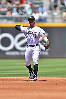 Charlotte Knights second baseman Yoan Moncada (10) warms up between innings during a game against the  Gwinnett Braves at BB&T Ballpark on May 7, 2017 in Charlotte, North Carolina. The Knights defeated the Braves 7-1. (Tony Farlow/Four Seam Images)