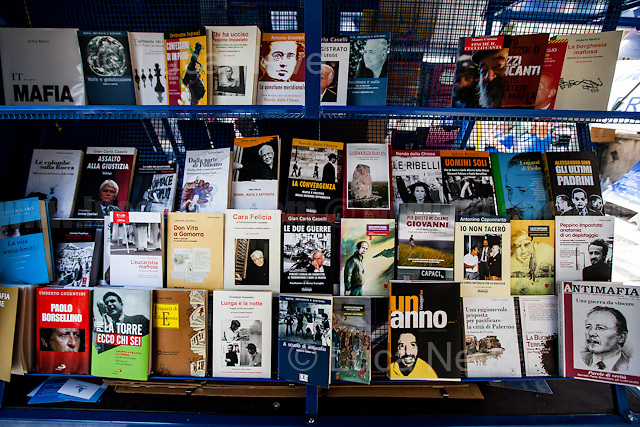 """Books.<br /> <br /> Palermo (Sicily - Italy), 19/07/2017. """"Basta depistaggi e omertà di Stato!"""" (""""Stop disinformation and omertá by the State!"""") (1). Public event to commemorate the 25th Anniversary of the assassination of the anti-mafia Magistrate Paolo Borsellino along with five of his police """"scorta"""" (Escorts from the special branch of the Italian police force who protect Judges): Agostino Catalano, Emanuela Loi (The first Italian female member of the police special branch and the first woman of this branch to be killed on duty), Vincenzo Li Muli, Walter Eddie Cosina and Claudio Traina. The event was held at Via D'Amelio, the road where Borsellino was killed. Family members of mafia victims, amongst others, made speeches about their dramatic experiences, mafia violence and unpunished crimes, State cover-ups, silence ('omertá'), and misinformation. Speakers included, amongst others, Vincenzo Agostino & Augusta Schiera, Salvatore & Cristina & Antonella Catalano, Graziella Accetta & Ninni Domino, Massimo Sole, Paola Caccia, Luciano Traina, Gianluca & Angela Manca, Nunzia & Stefano Mormile, Ferdinando Imposimato, Judge Nino Di Matteo. The event ended with the screening of the RAI docu-fiction, 'Adesso Tocca A Me' ('Now it's My Turn' - Watch it here: http://bit.ly/2w3WJUX ) by G. Filippetto & F. Miccichè.<br /> <br /> For more info & a video of the event please click here: http://bit.ly/2eQfNT3 & http://bit.ly/2eQbmrj & http://19luglio1992.com & http://bit.ly/2he8hCj<br /> <br /> (1) 'Omerta' is the term used in Italy to refer to the code of silence used by mafia organisations, as well as the culture of silence that is entrenched in society at large (especially among victims of mafia crimes, as they fear recriminations), about the existence of organised crime and its activities."""